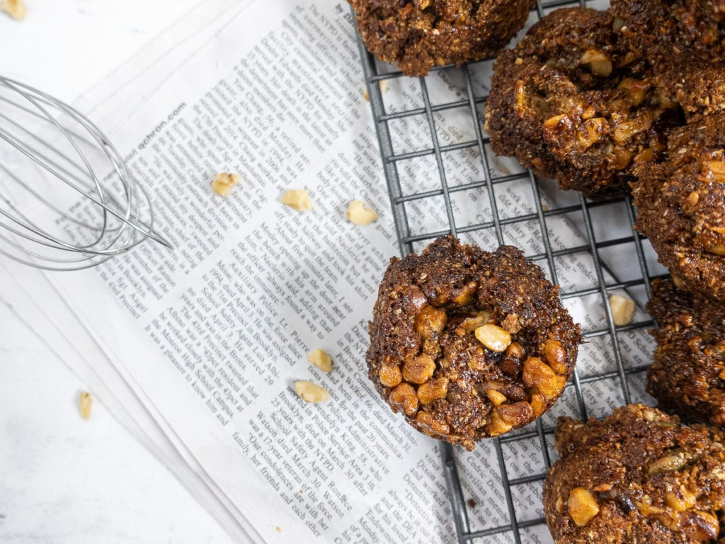 Muffins on top of news paper.