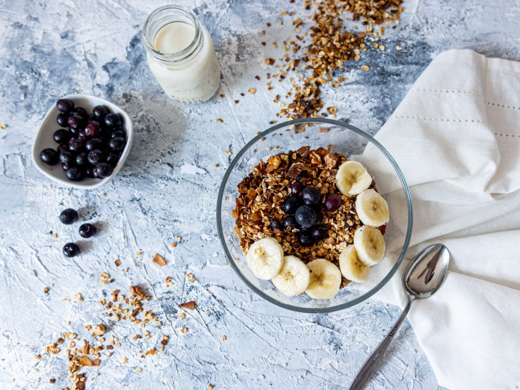 Bowl of granola and glass of milk