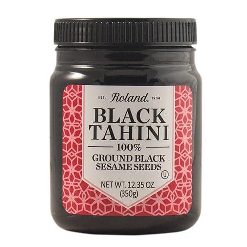 Jar of black tahini