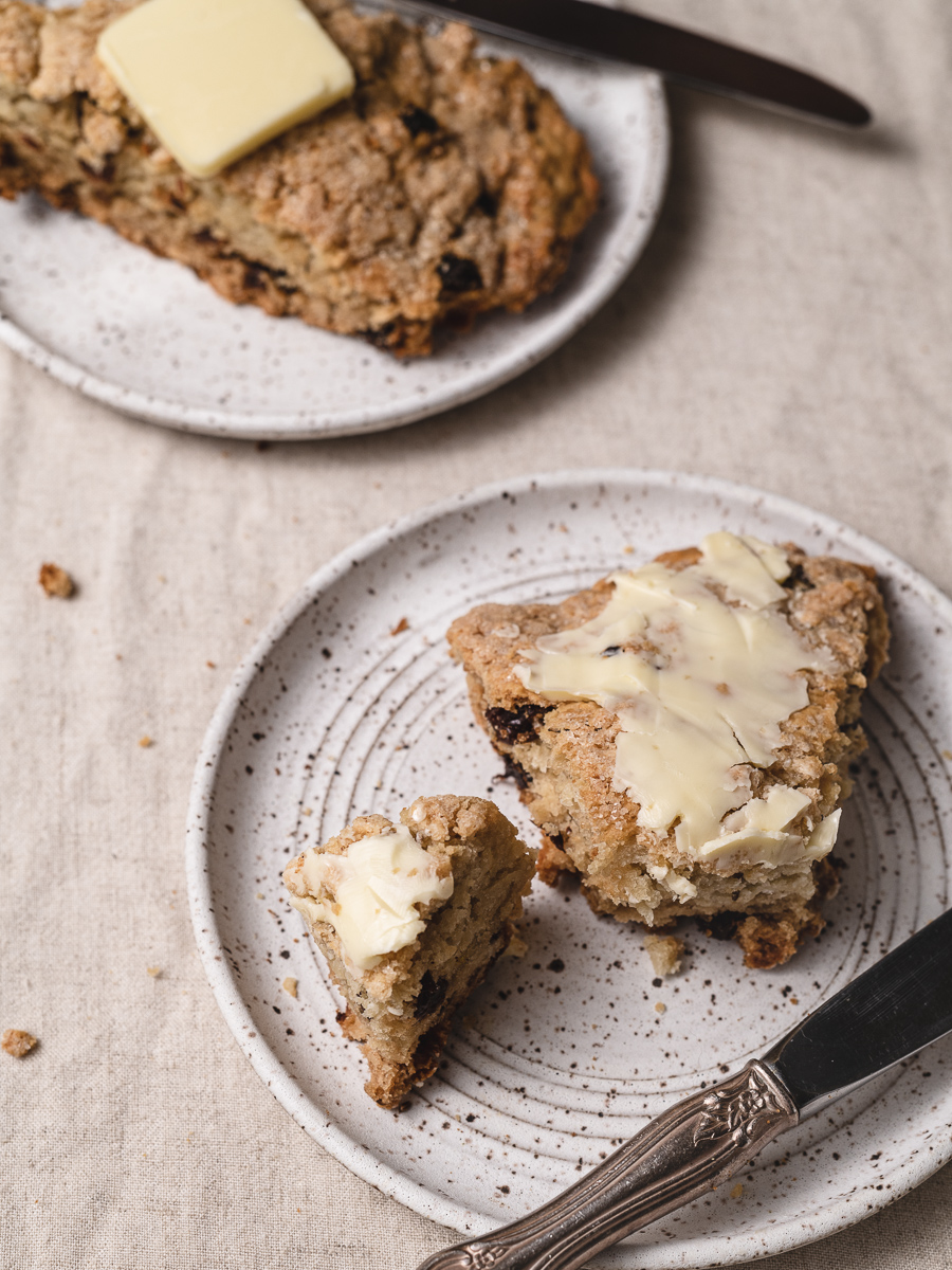 slices of soda bread slathered in butter on a plate