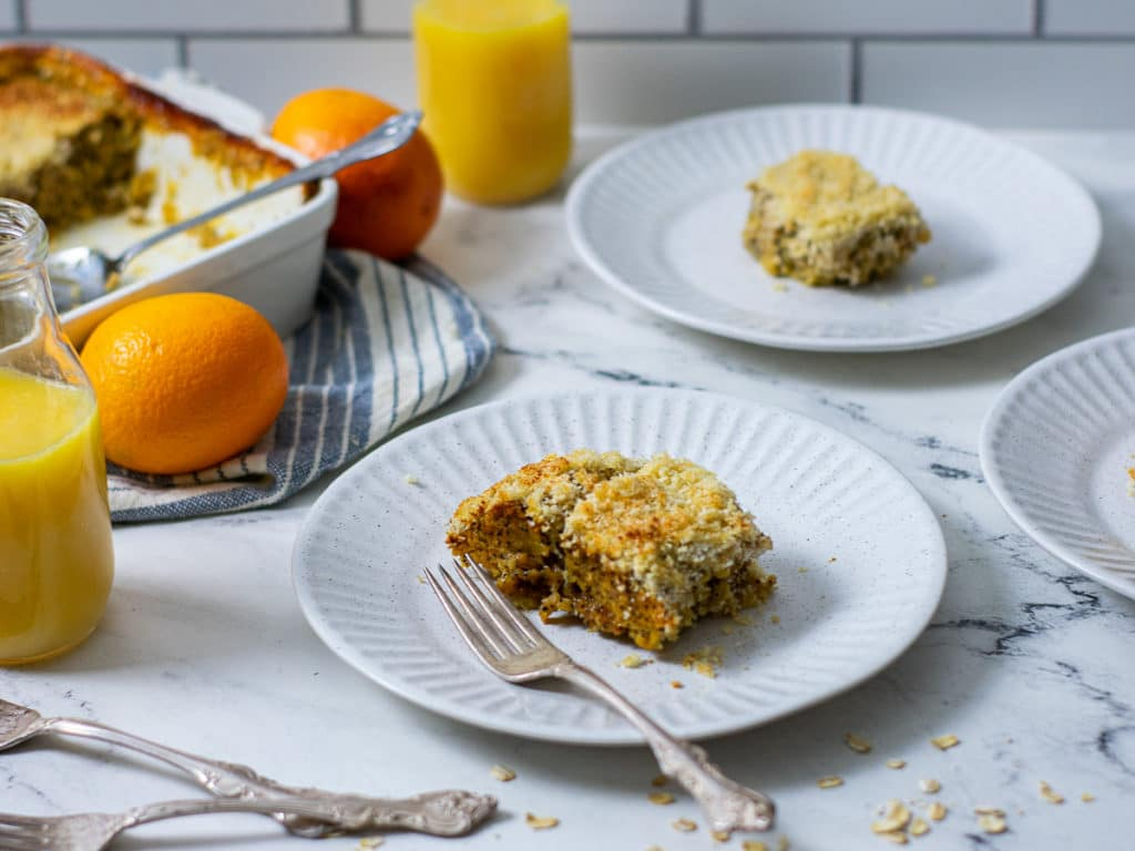Slices being served of orange poppyseed baked oatmeal.