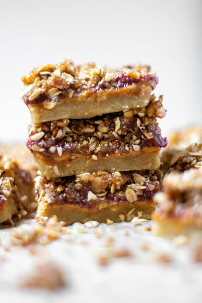 three pb&j bars stacked made from almond flour
