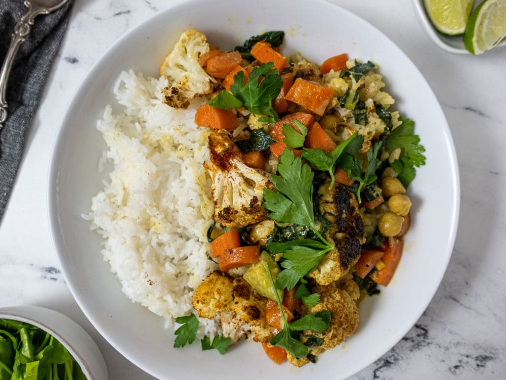 Bowl of roasted cauliflower curry and rice