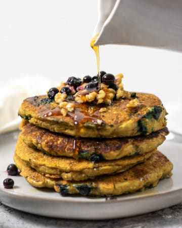 Stack of healthy vegan buttermilk pancakes with maple syrup