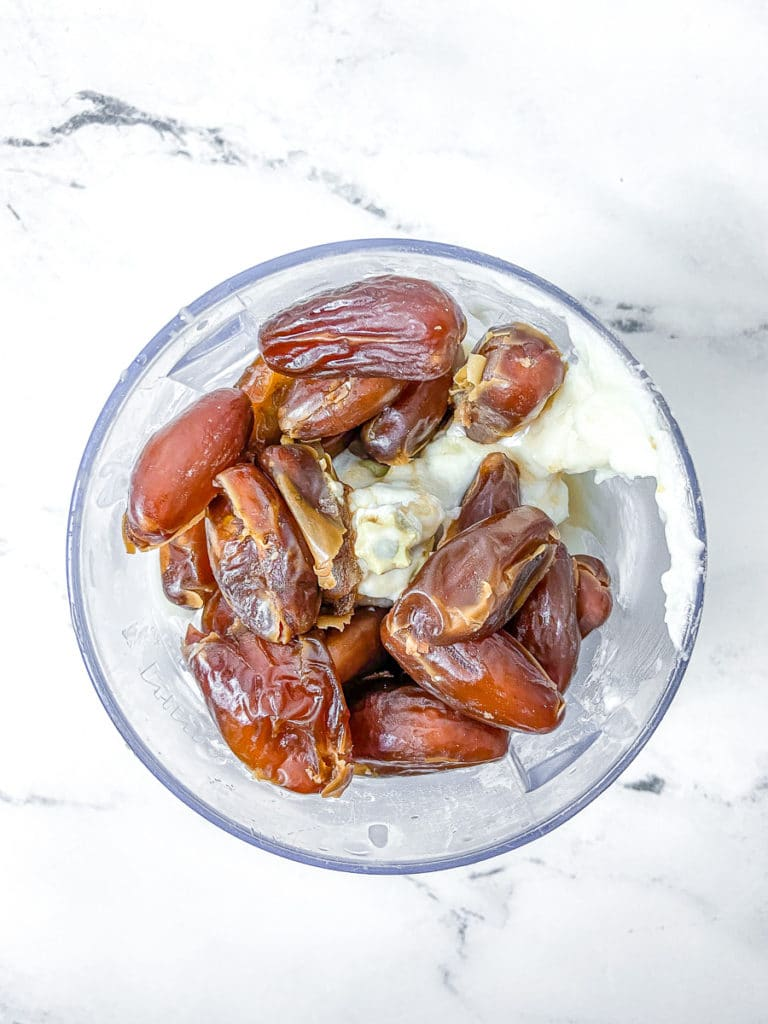Dates, coconut cream, and tahini in a blender.
