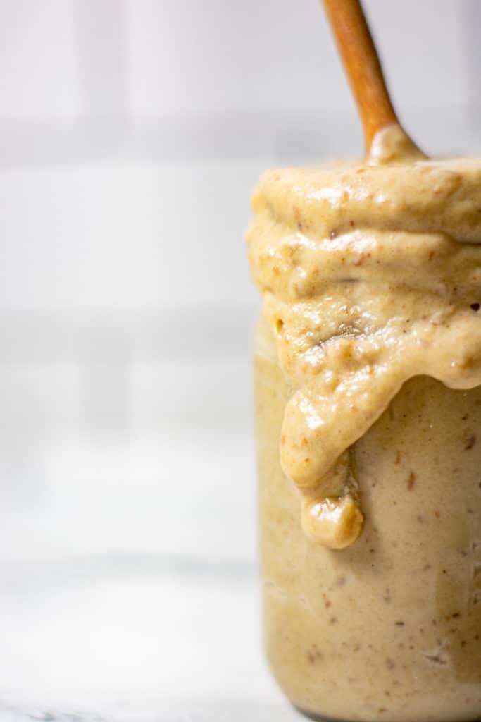 Drippy jar of caramel sauce