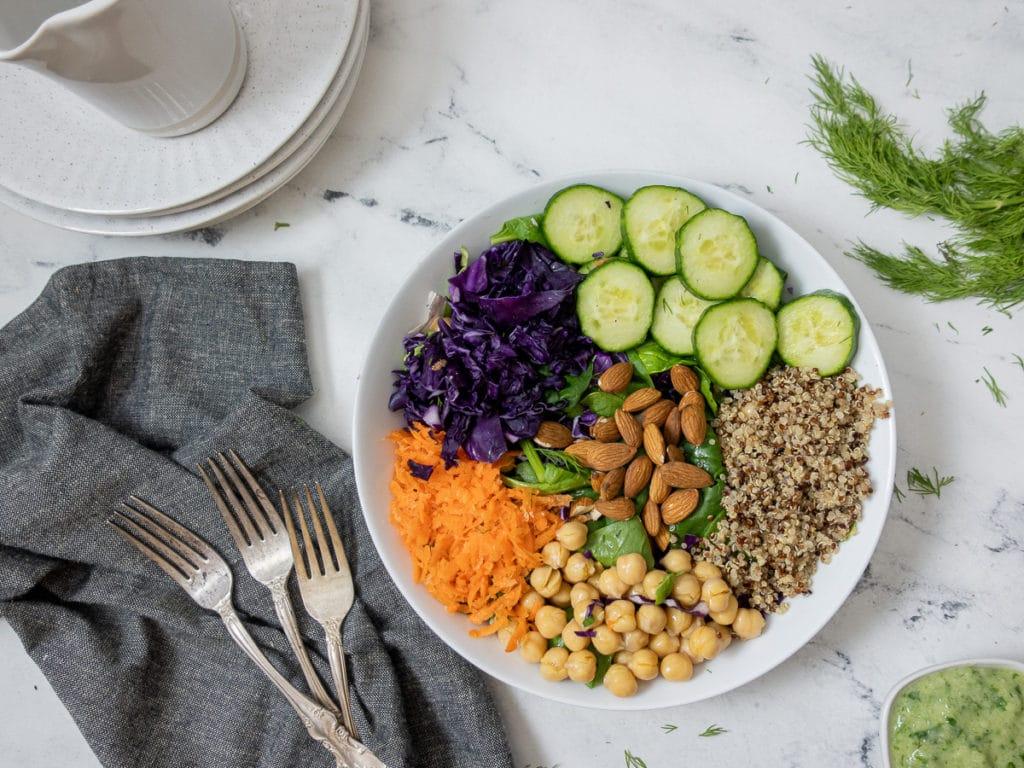 Big bowl of salad ready for vegan yogurt cilantro dressing.