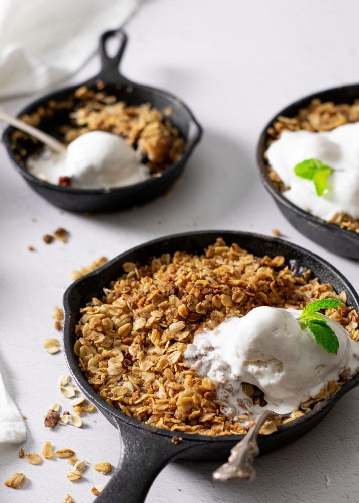 melted ice cream on top of hot peach crisp