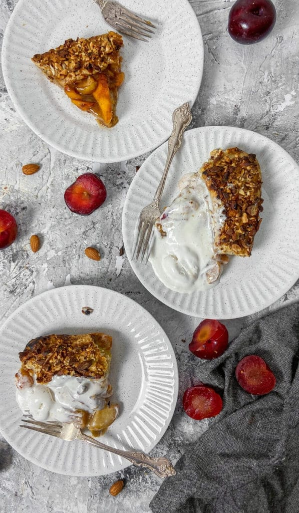 Three slice of peach galette with melted ice cream!