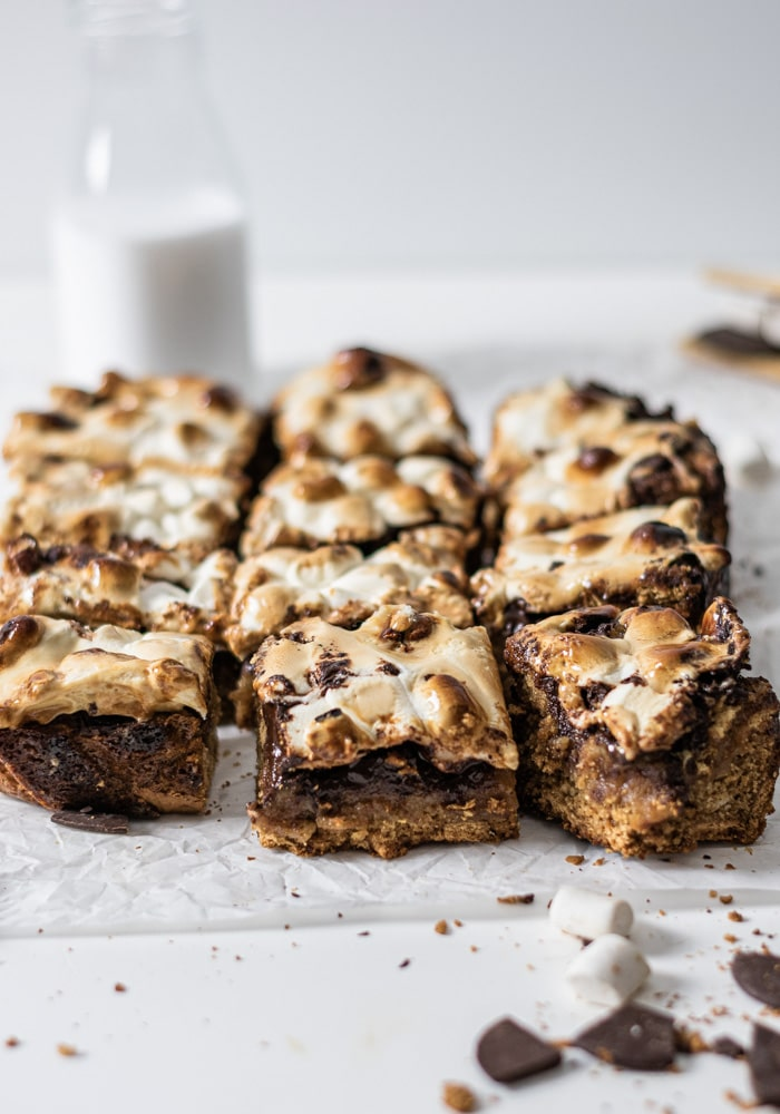 marshmallows and chocolate ingredients scattered with blondie bars.
