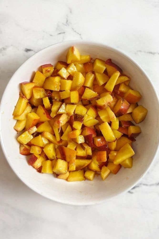 ingredients for scones, peaches diced in a bowl.