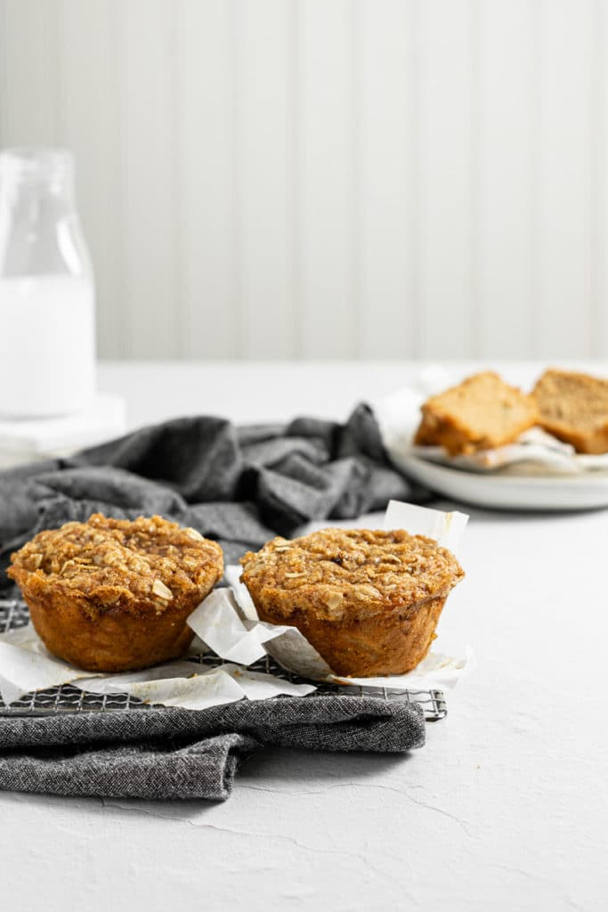 two apple cinnamon muffins cooling