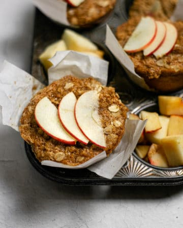 apple cinnamon muffins fresh out of the oven in the pan