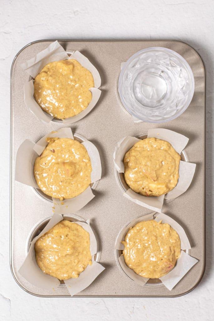 filling the jumbo muffin tin