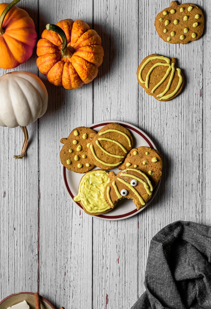 Plate of pumpkin cookies and pumpkins