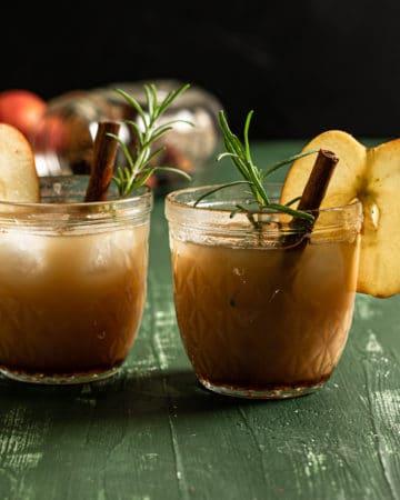 shot of two apple cider cocktails
