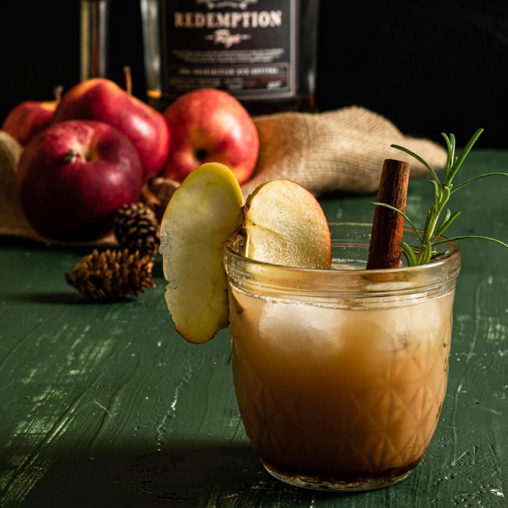 Close up of redemption rye bottle for a bourbon apple cider cocktail