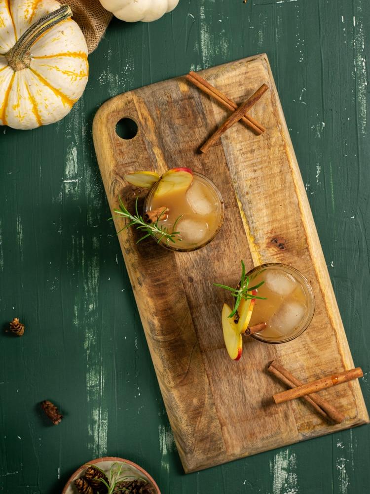 two bourbon apple cider drinks on display