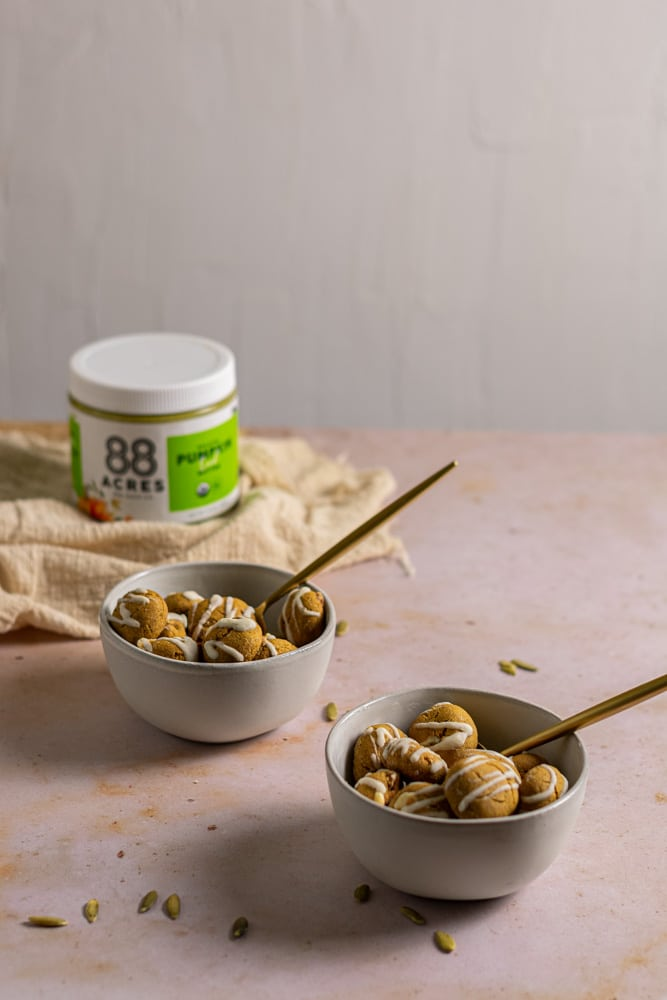 two bowls of cookie cereal with a featured jar of pumpkin seed butter form 88 acres.