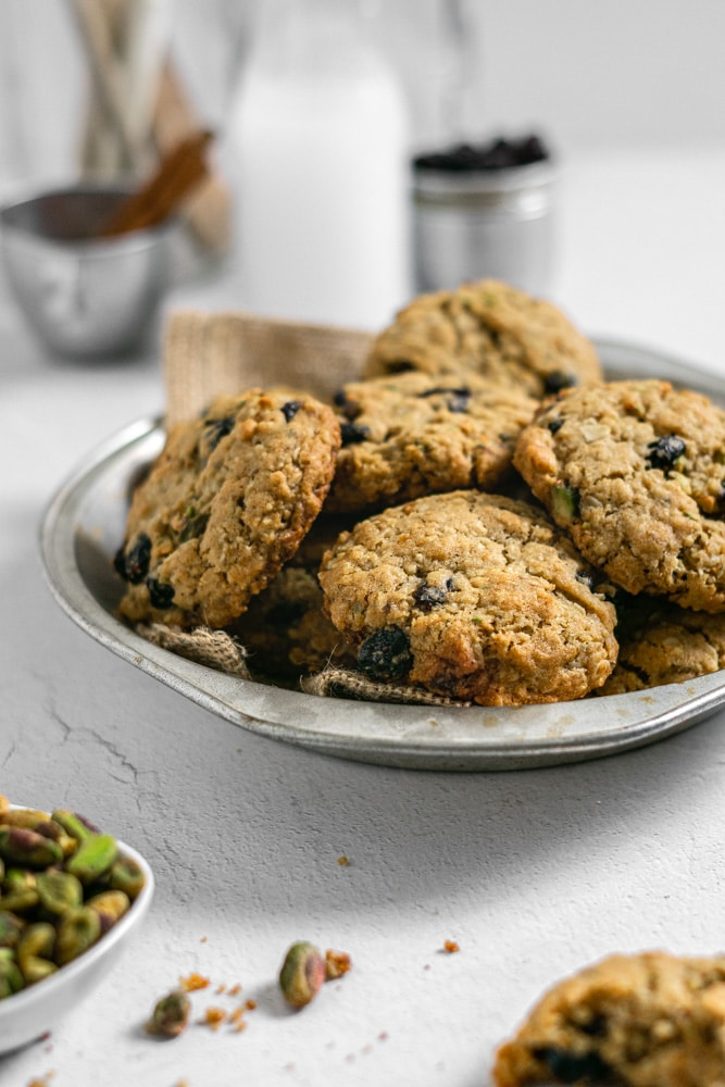 close up of oatmeal cookies with pistachios and cranberries