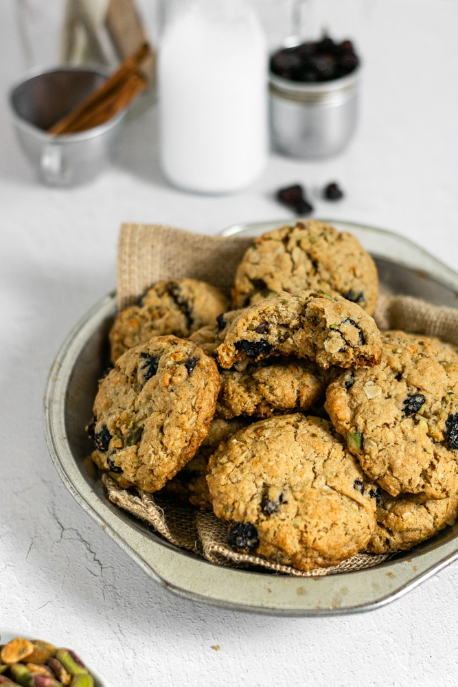 a bite out of an oatmeal pistachio cookie