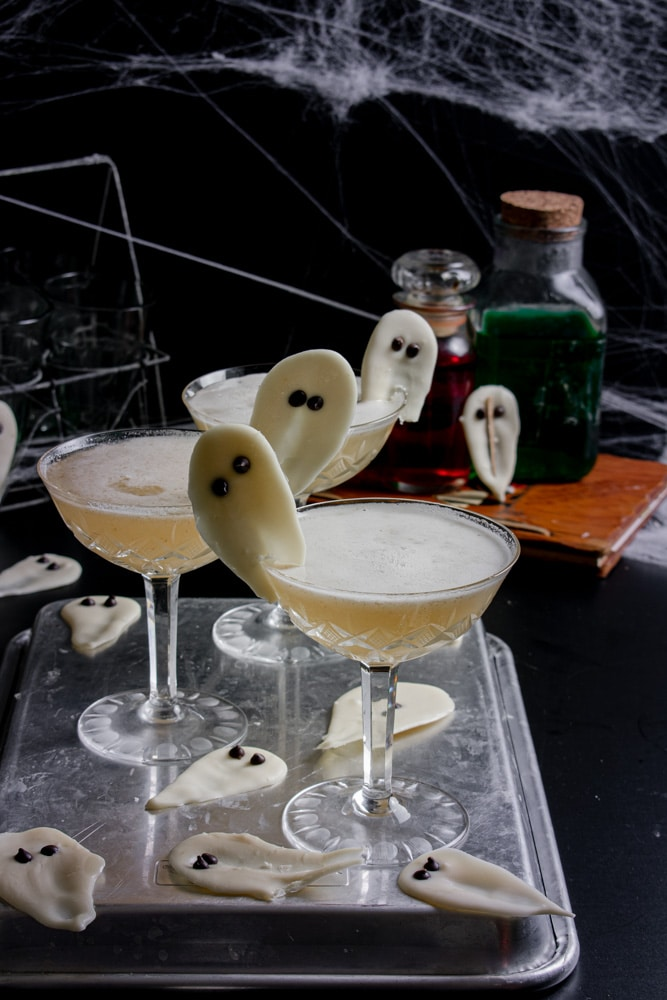 Casper cocktails in a spooky scene with spider webs and a bottle of tequila.
