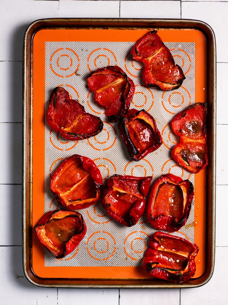 Red peppers that have been roasted.