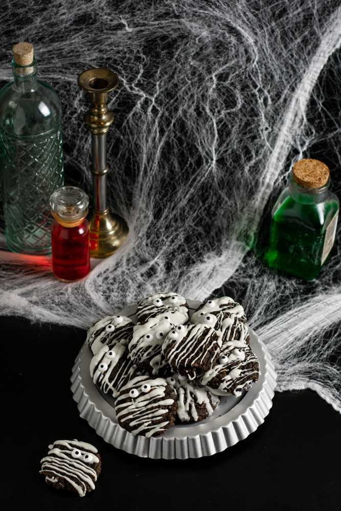 Table of spooky things and a plate of cookies with spider webs
