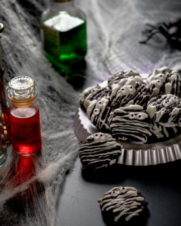spooky table of potions and mummy vegan brookies