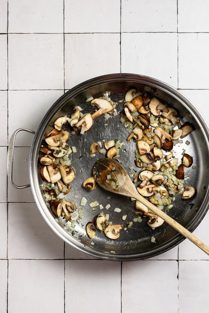 mushrooms and onions cooking in olive oil