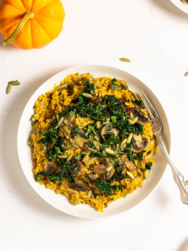 finished dish of risotto with sautéed kale and mushrooms on top