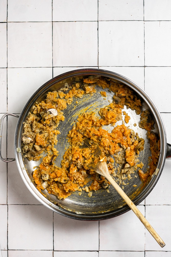 showing the process of making pumpkin risotto