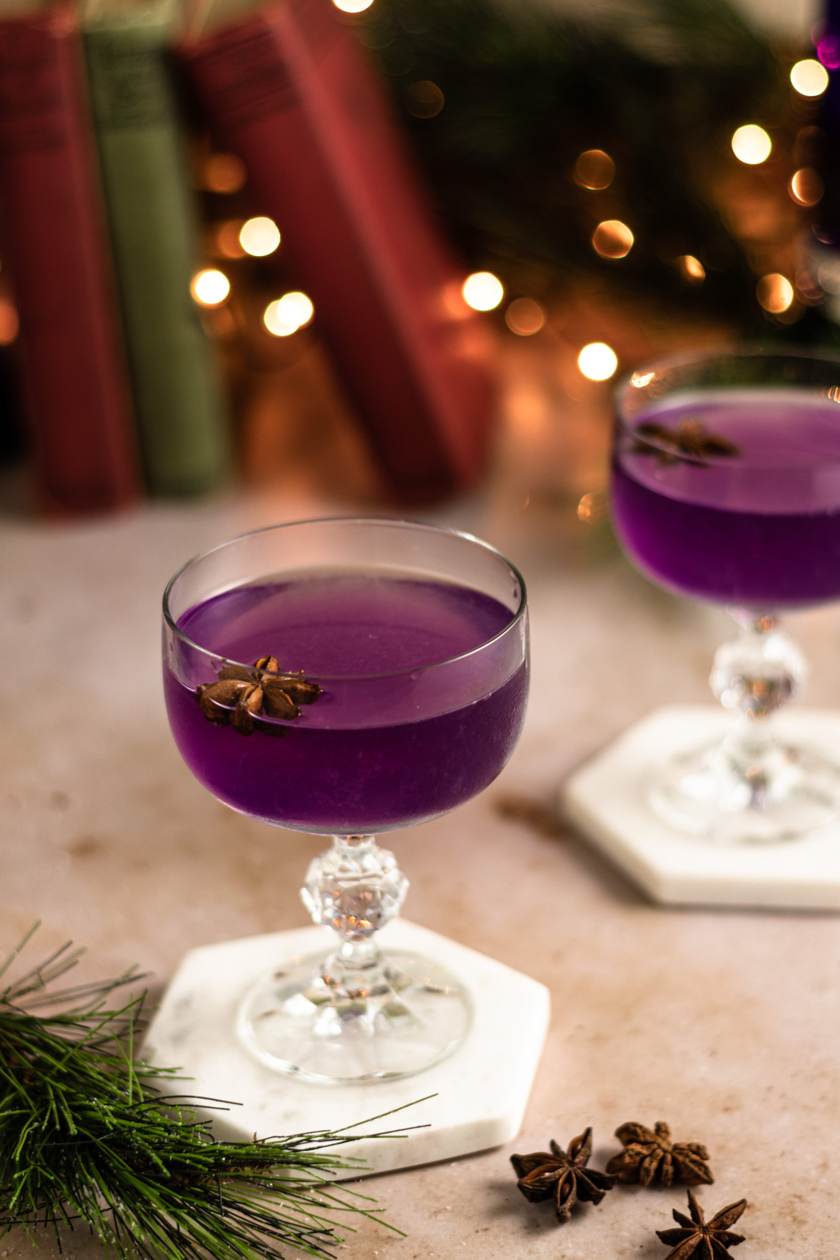 Two gin cocktails with star anise on top