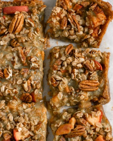 Close up of caramel and pecans on caramel apple bars