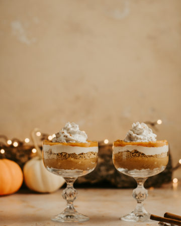 Two vegan cheesecake parfaits in crystal glasses