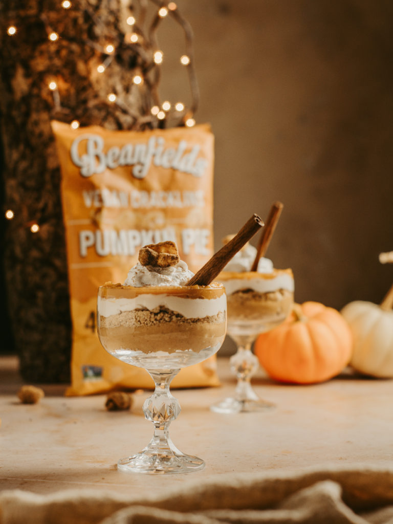 Finished pumpkin cheesecake parfaits with whip cream and a pumpkin pie cracklin on top!