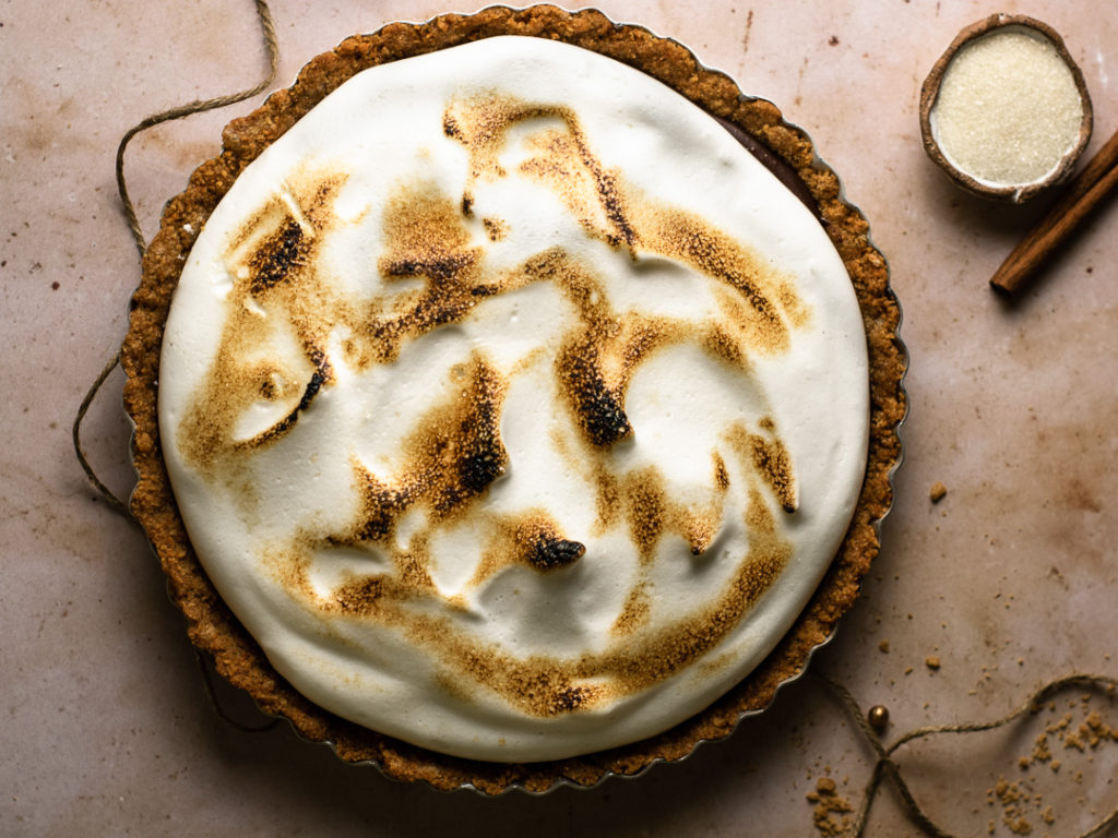 chocolate tart with spicy chili and meringue topping.