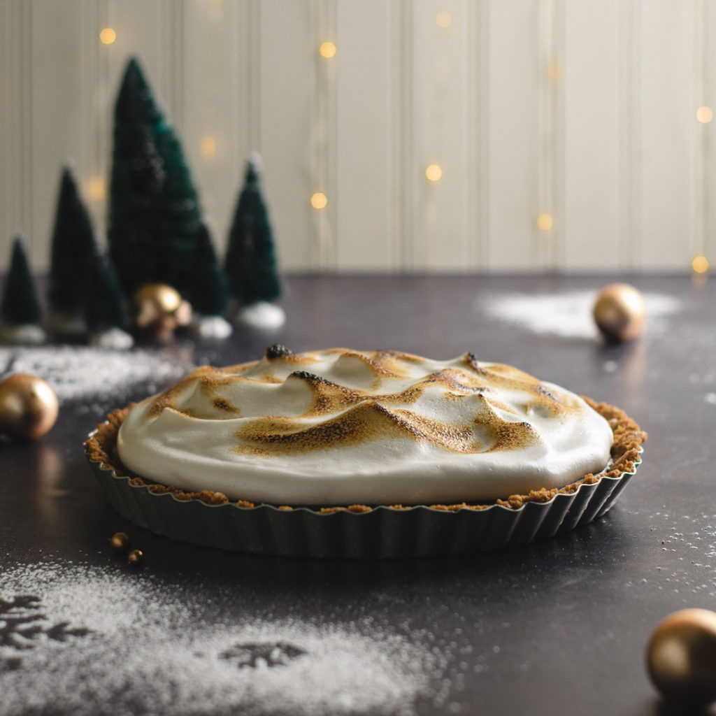 Toasted meringue topping on a dark chocolate dairy free tart.