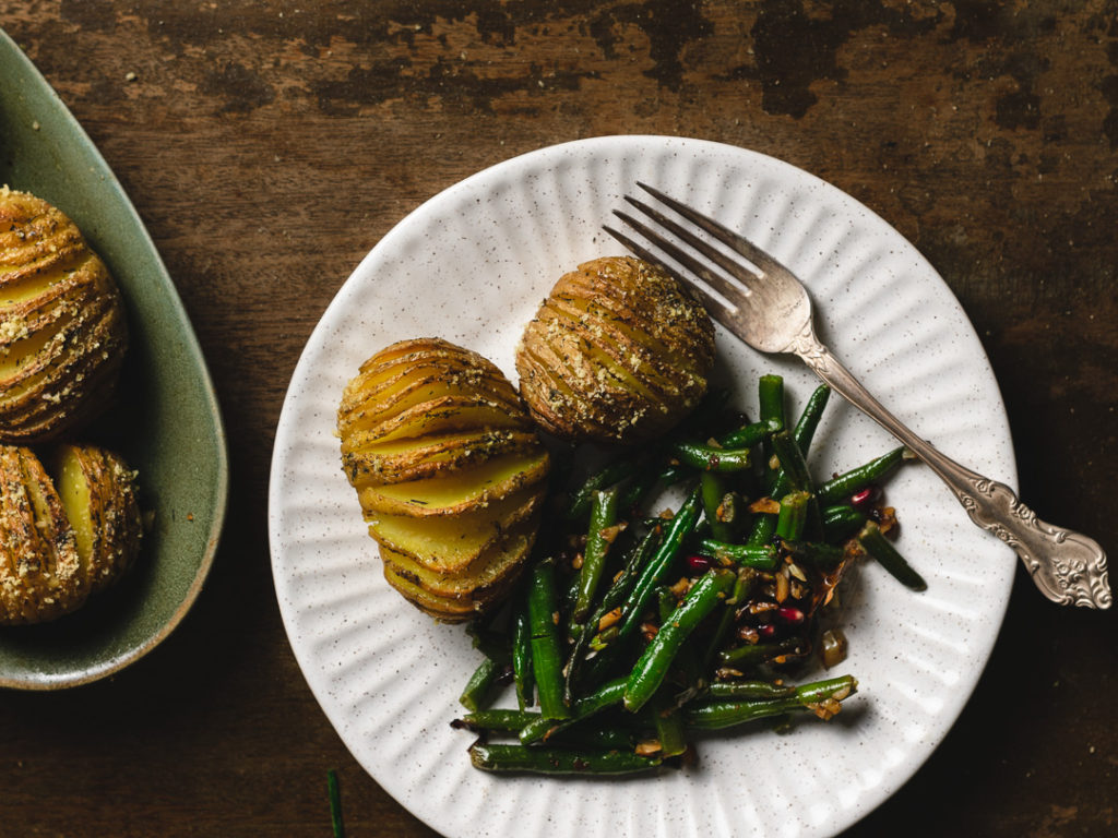 Dinner plate with a serving of potatoes and green beans.