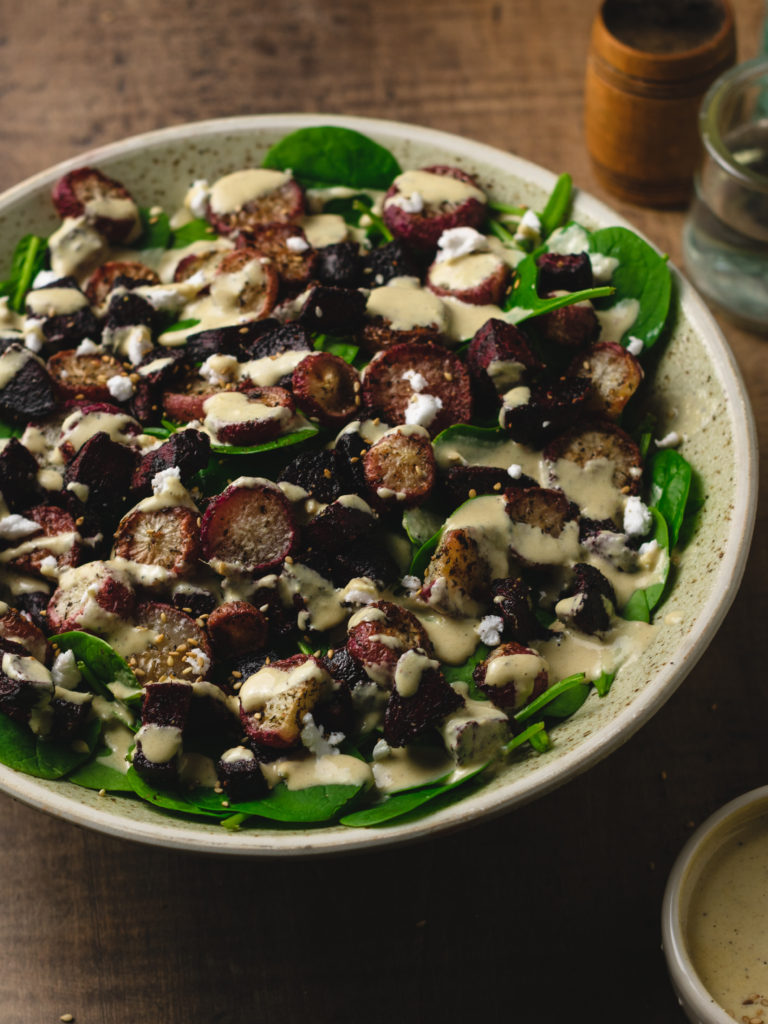 Finished spinach salad drizzeld with orange ginger tahini dressing!