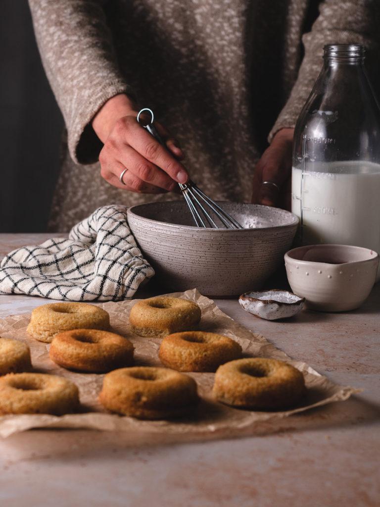 Stirring the vanilla glaze.