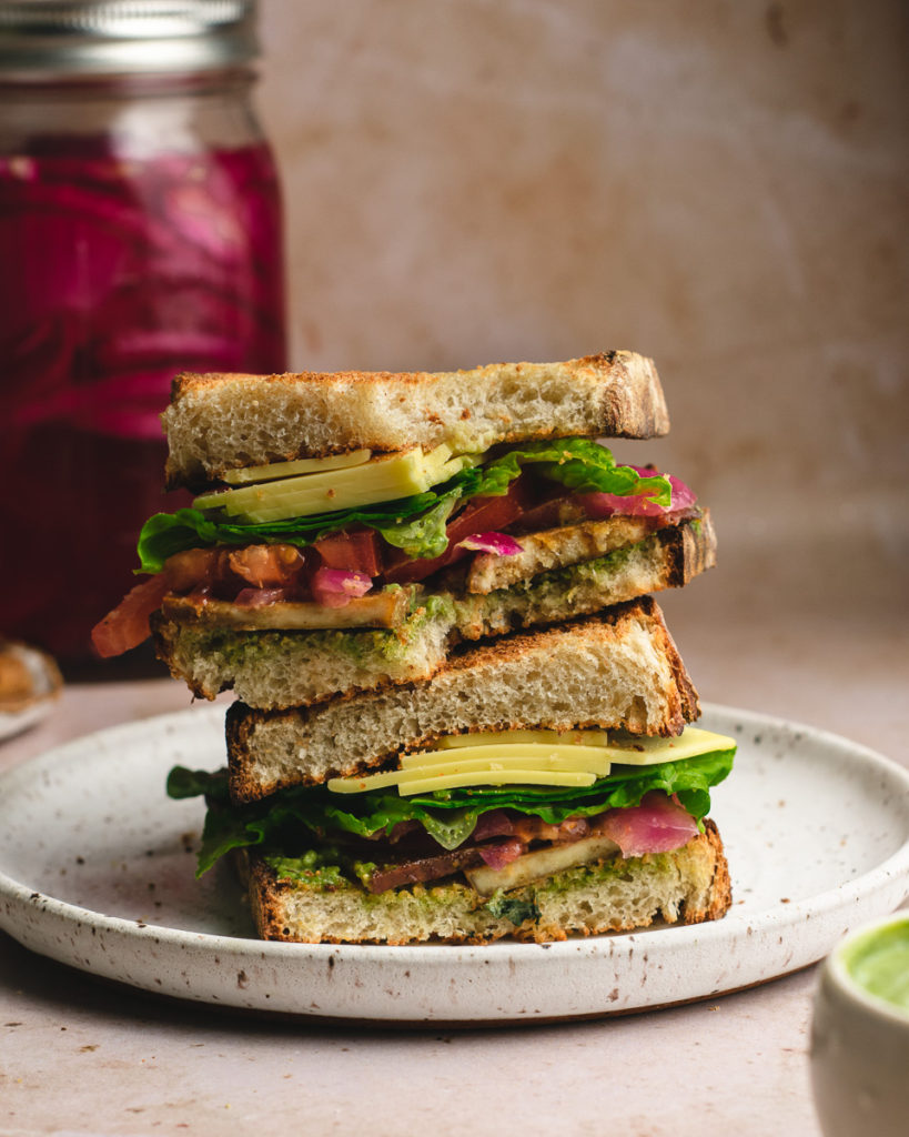 Big vegan BLT sandwich with a bite out of it!