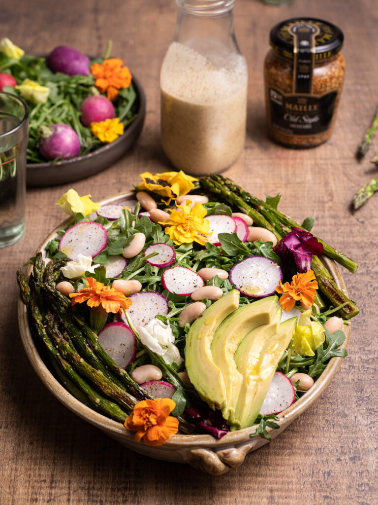 Colorful spring salad with asparagus and radishes. Plus there is edible flowers too!