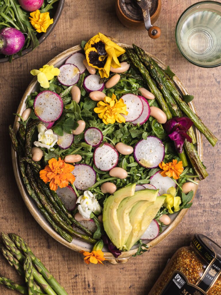 big beautiful salad with mustard vinegarette and wild flowers
