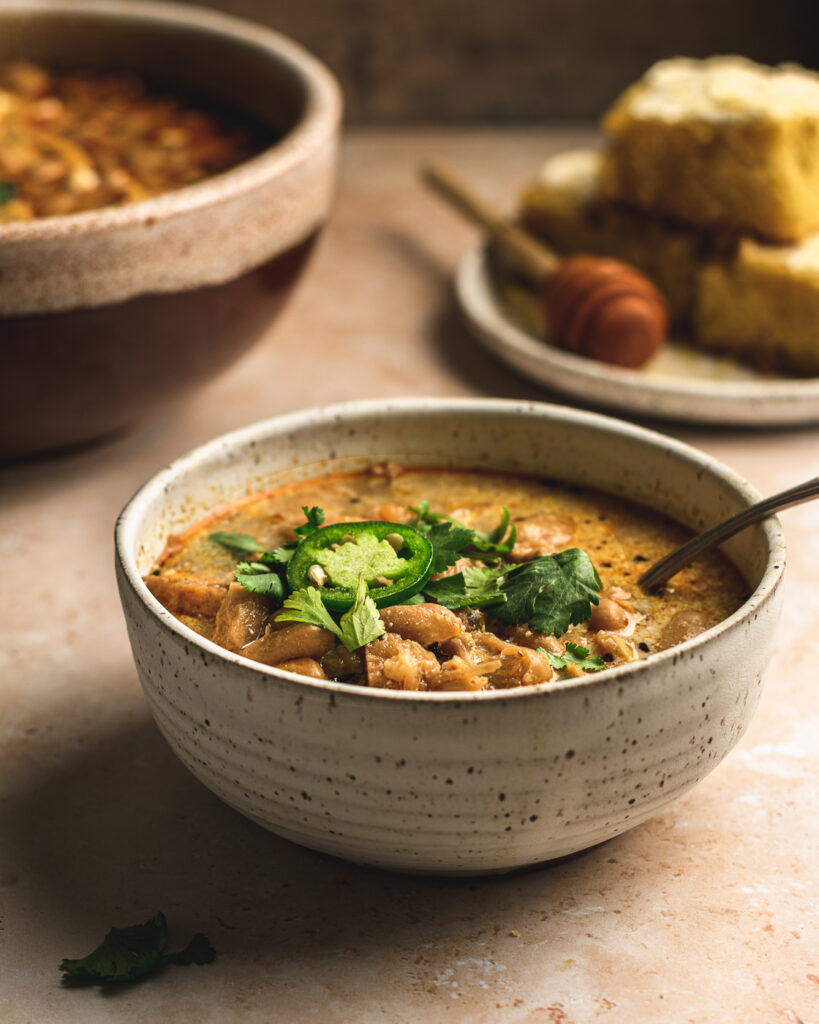 Bowl of white bean chili made with jackfruit.