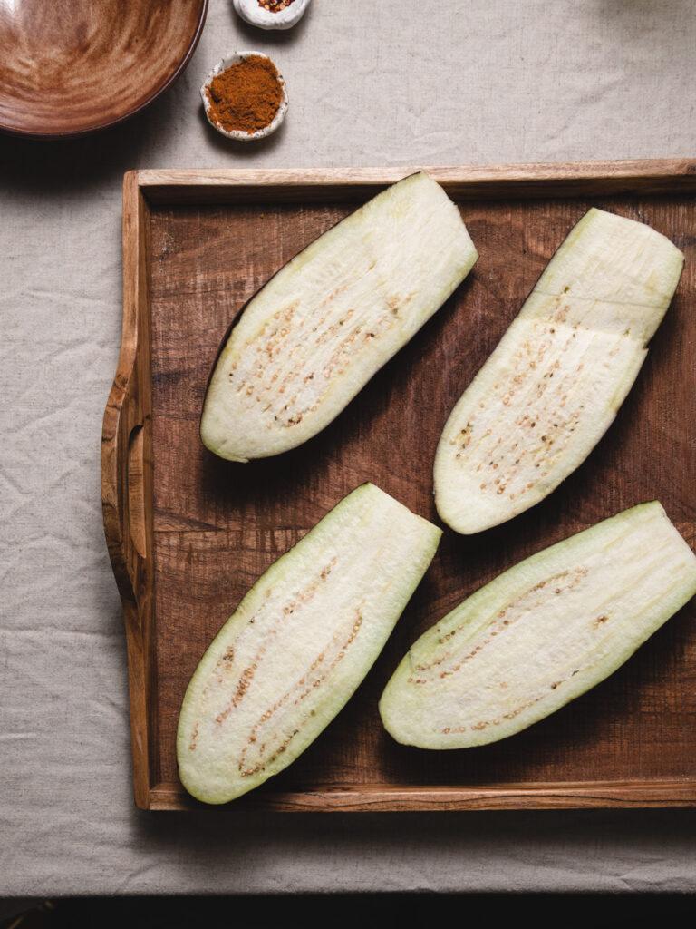 sliced eggplant halves showing how to cooke eggplant