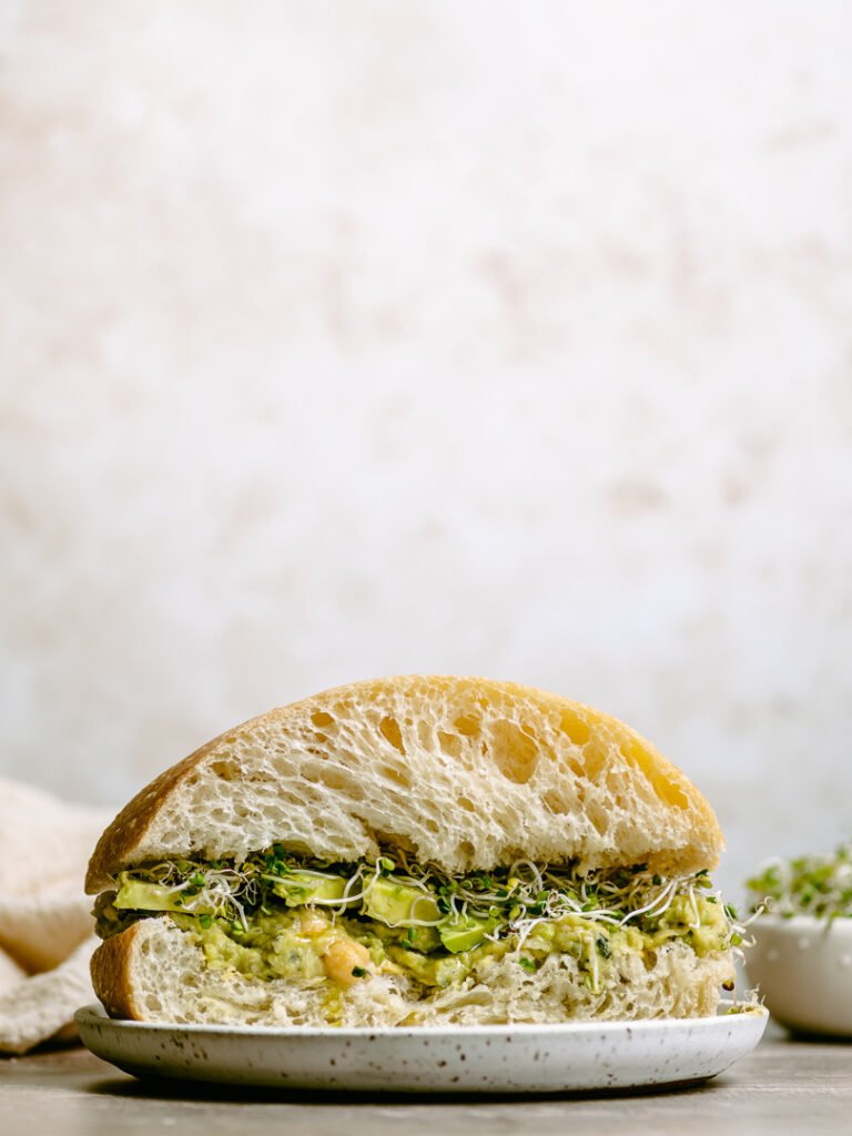 cibatta roll with smashed chickpeas and avocado